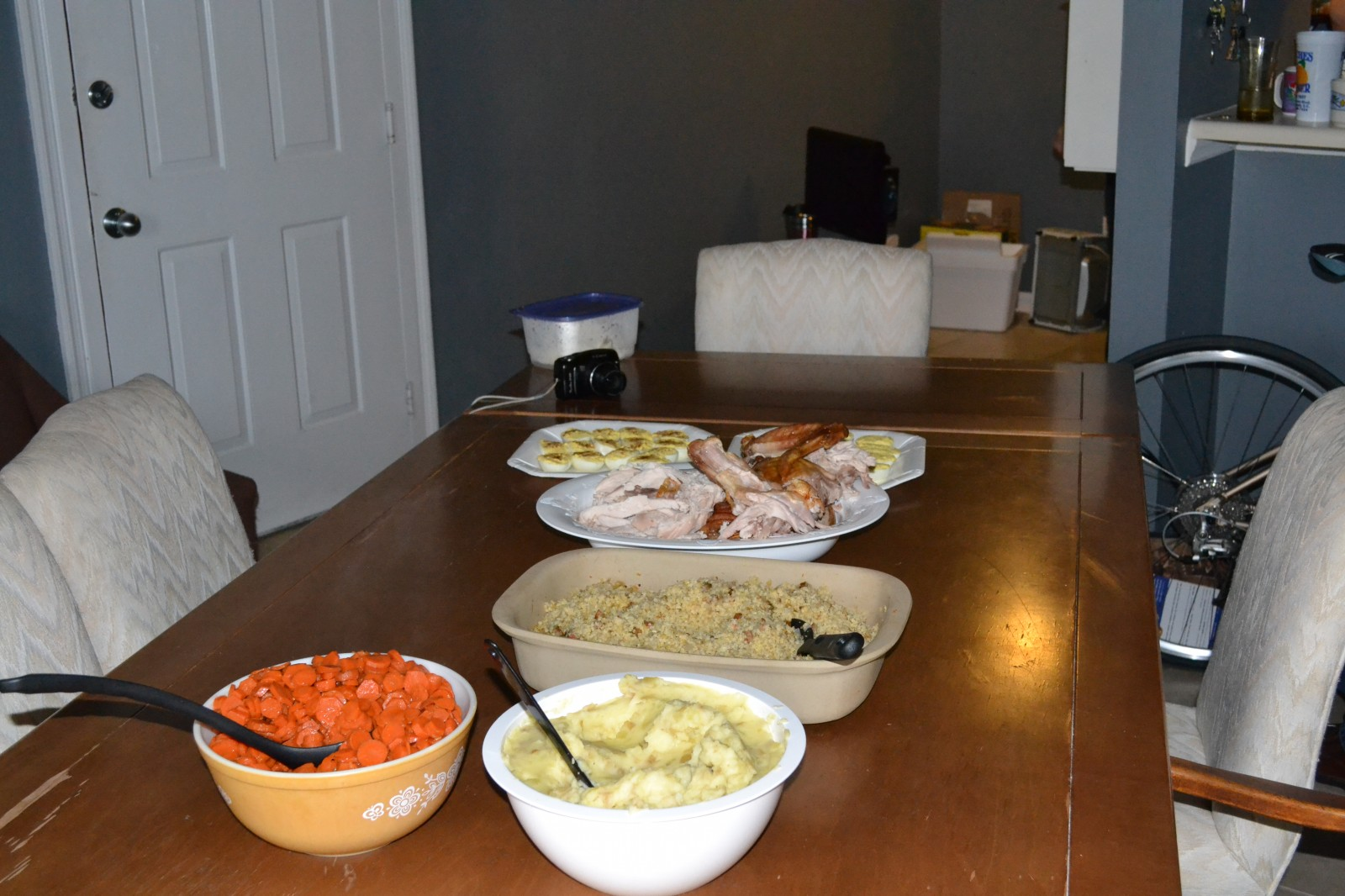 Carrots, mashed potatoes, turkey, dressing, and deviled eggs.