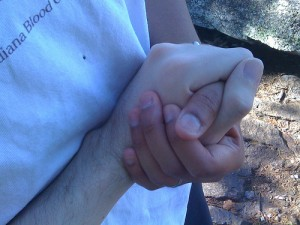 Holding hands at Crowder's mountain as we got engaged.