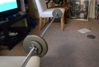 The barbell, set up for bench press.