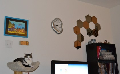 The TV wall of the living room, with R'lyeh, our clock, and the 'fall' over the bookcase.