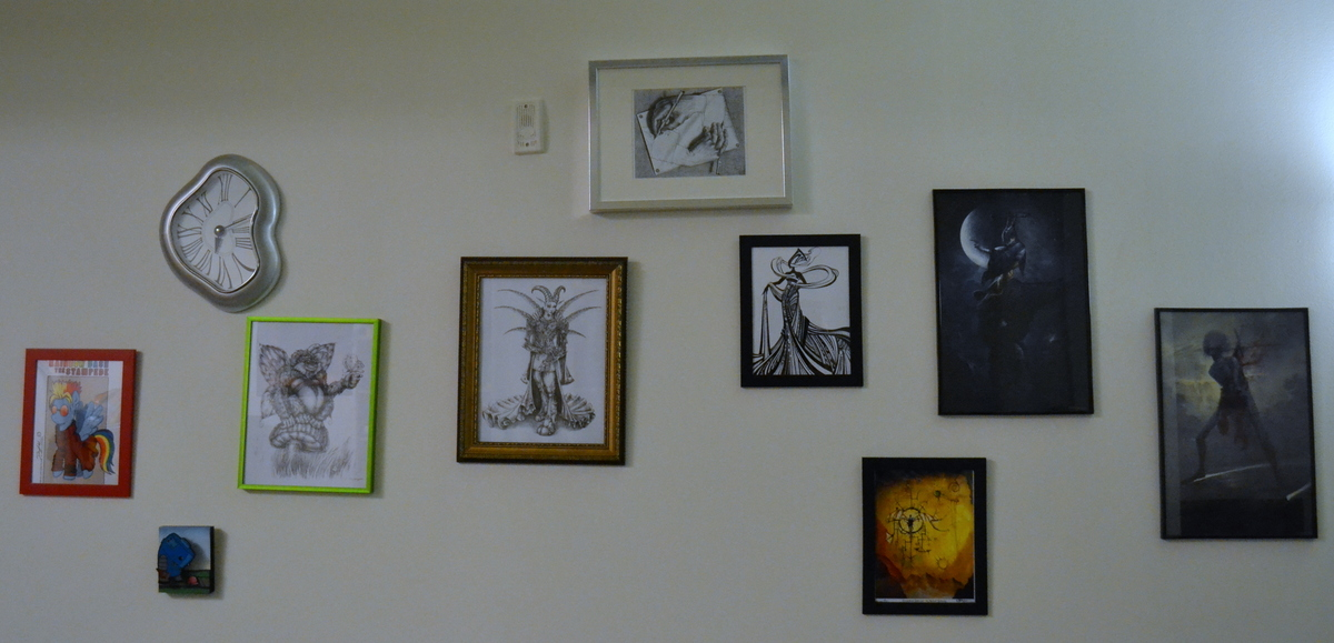 The full spread of art acquired (mostly) at DragonCon.